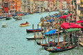 Venetian cityscape from rialto bridge venice november view of grand canal gondolas and promenade with bars and restaurants one of Royalty Free Stock Images