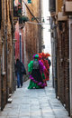 Venetian Costumes on a Narrow Street in Venice Royalty Free Stock Photography