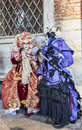 Venetian costumes scene venice italy february th image of two persons disguised in specific posing near the doge s palace during Royalty Free Stock Photos