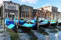 Venetian gondolas on canal with medieval buildings in background Royalty Free Stock Photo