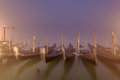 Venetian gondolas and lamps in a long time exposure in the night Royalty Free Stock Photo