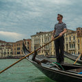 Venetian gondolier and gondola on the grand canal venice italy Royalty Free Stock Photos