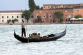 Venetian gondolier in the grand canal of venice Royalty Free Stock Images