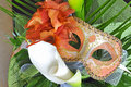 Venetian mask and flowers Stock Images