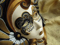 Venetian mask on gold background Stock Photography