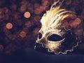 Venetian mask golden over black background Stock Images