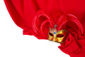 Venetian mask on red fabric with feathers Stock Photos