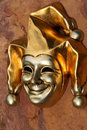 Venetian mask of smiling joker Stock Images