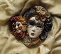 Venetian masks carnival on gold fabric background Royalty Free Stock Image