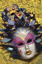 Venetian masks decorated on golden background Royalty Free Stock Image