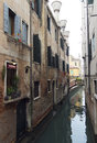 Venetian narrow river Royalty Free Stock Photo