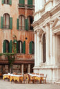 Venetian restaurant outside tables on the piazza Royalty Free Stock Photo