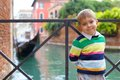 Venetian view and boy summer tourist venice italy Stock Photo