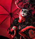 Venetian woman with red umbrella Stock Image
