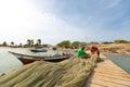 Venezuelan fishermen working on wooden pier on Isla Margarita Royalty Free Stock Photo