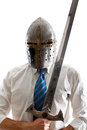 Vengeance a young businessman isolated on a white background holding a steel sword and wearing an helm Stock Image