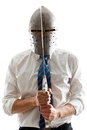 Vengeance a young businessman isolated on a white background holding a steel sword and wearing an helm Royalty Free Stock Images