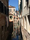 Venice canal with building reflection in the water Royalty Free Stock Photo