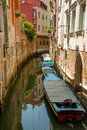 Venice canal colorful buildings and boats in passage Royalty Free Stock Images