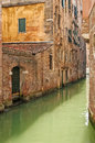 Venice cityscape, narrow old water canal and traditional buildings. Italy Stock Photos