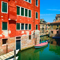 Venice cityscape water canal boats and traditional buildings italy europe long exposure photography Stock Photo