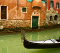 Venice gondola on small canal Royalty Free Stock Photography