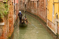 Venice gondola on small canal Royalty Free Stock Images
