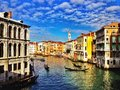 Venice grand canal with blue sky and gondolas Royalty Free Stock Image