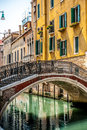 Venice italy ancient bridge crossing a canal in Stock Image