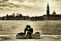 Venice italy april lovers in riva schiavoni in front of san giorgio maggiore on april in riva schiavoni in the Royalty Free Stock Photos