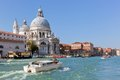 Venice italy basilica santa maria della salute and grand canal old venetian architecture boats at sunny day Stock Images