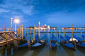 Venice italy beautiful san giorgio maggiore church traditional gondolas and street lamps illuminated in the early morning Royalty Free Stock Photos