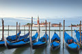 Venice italy beautiful san giorgio maggiore church traditional gondolas and street lamps illuminated in the early morning Royalty Free Stock Photo