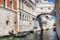 Venice italy the bridge of sighs and gondola floats on a canal among old venetian architecture Royalty Free Stock Image