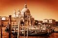 Venice italy gondolas on grand canal and the salute basilica santa maria della vintage style golden tint Stock Photo