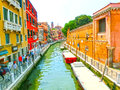 Venice, Italy - June 06, 2015: People on the street in Venice, Italy