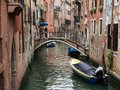 Venice italy may view of a side canal and old buildi buildings in the centre couple with umbrella standing on the bridge Royalty Free Stock Photography