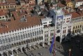 Aerial view of the St Mark`s Clocktower on St Mark`s Square Piazza San Marco from St Mark`s Campanile bell tower Royalty Free Stock Photo