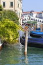 View on Grand Canal with gondolas in the harbor and Rialto Bridge Ponte de Rialto , Venice, Italy Royalty Free Stock Photo