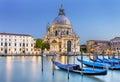 Venice la salute gondola on canal grande with basilica di santa maria della in the background italy Stock Image