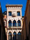 Venice old house architecture windows sculpture Royalty Free Stock Photo