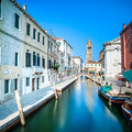 Venice san barnaba cityscape water canal church and boats ita campo campanile on background building long exposure photography Royalty Free Stock Photo