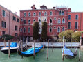 Venice a view of gondolas on the grand canal gondols anchoring grande in front an ancient palace Stock Photos