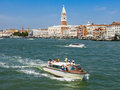Venice waterfront view cruising touristic boats quay riva degli schiavoni and doge s palace italy Stock Photo