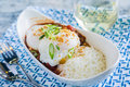 Venison chili loco moco with rice and a poached egg Royalty Free Stock Photography