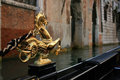 Venitian gondola decor a s golden seahorse sculpture in venice italy Stock Images