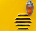 Ventilation grill and indicator direction on yellow surface Royalty Free Stock Image