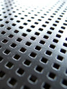 Ventilation holes on a metal plate italy Royalty Free Stock Photo
