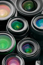 Verious photo lenses close up of many various with colorful antireflection multi layer coating Stock Photography