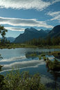Vermillion lakes banff alberta canada in the bow river valley just outside the town of mount rundle distant against the sunrise Stock Photo